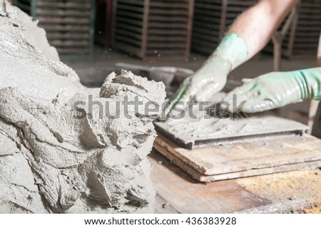 Mixture of clay and lavic sand ready to be modelled to make red bricks