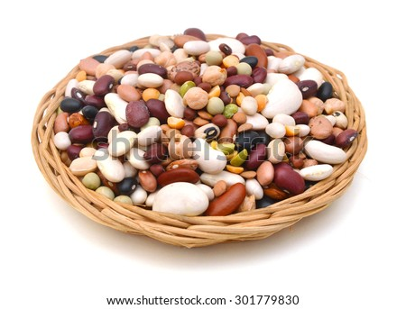 mixture of legumes in basket on white background. - stock photo