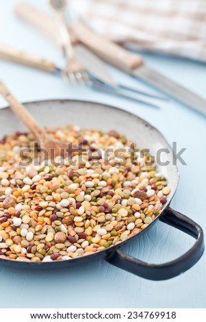 mixture of legumes in pan - stock photo