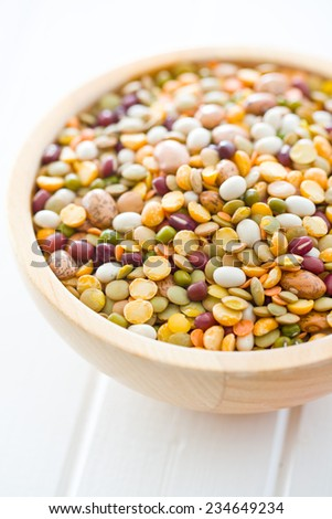 mixture of legumes in wooden bowl - stock photo