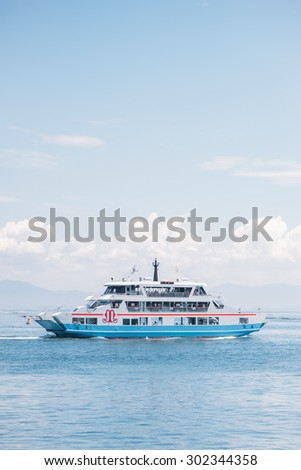 MIYAJIMA,JAPAN - July 8: Matsudai Kisen ferries crossing the inland sea between Miyajimaguchi and Miyajima on 8th July 2015. The Ferries carry visitors to the Itsukushima Shrine on Itsukushima island.