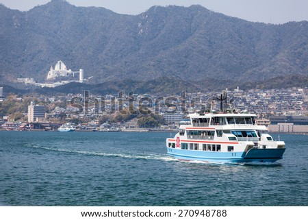MIYAJIMAGUCHI, JAPAN - CIRCA APR, 2013: Ferry of Matsudai Kisen company goes to the island of Miyajima (Itsukushima) from Miyajimaguchi ferry-port. The Hiroshima gulf, Japan