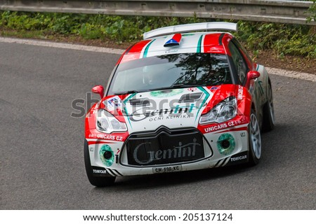 MLADA BOLESLAV, CZECH REP. - JULY 11 : Driver Jake���¡ M. and co driver Nov���¡k in Citroen DS3 R5 at speed stage no. 3 during Bohemia Rally July 11, 2014 in Mlada Boleslav, Czech Republic. - stock photo