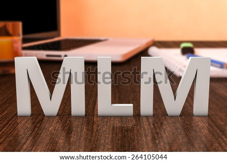 MLM - Multi Level Marketing - letters on wooden desk with laptop computer and a notebook. 3d render illustration. - stock photo