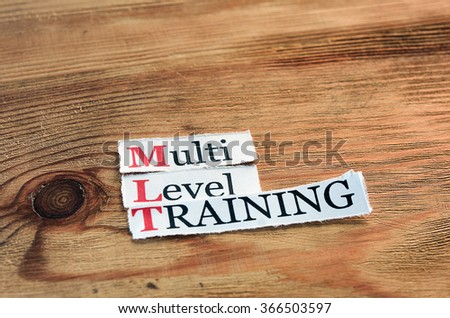 MLT- Multi Level Training written on paper on wooden background