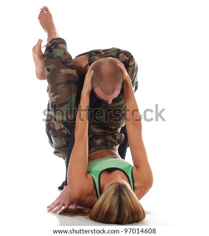 MMA female instructor applying a Jiu-Jitsu triangle choke from the guard - stock photo