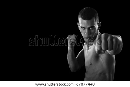 MMA - Mixed martial art warrior  punching.Selective focus on fighter - stock photo