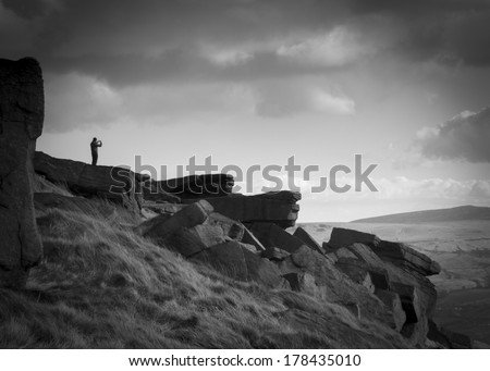 Mn taking a photo at Buckstone edge calderdale west yorkshire - stock photo