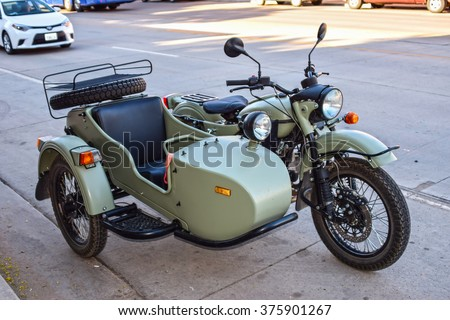 MOAB, USA - June 4: Ural motorbike with sidecar on June 4, 2015 on Main Street in Moab, Utah, USA. Ural is a Russian brand of heavy sidecar motorcycles originally made in the soviet union during WW II
