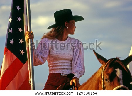 MOAB, UTAH - JULY 4: Undefined participant at ceremonial parade at rodeo held on the occasion of Independence Day on July 4, 1996 in Moab, Utah, USA. - stock photo