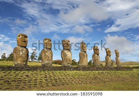 Moai of Easter island, symbol of Polynesian culture at the Ahu Akivi sacred site - stock photo