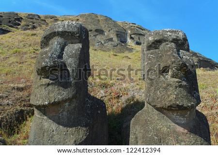 Moai of Rano Raraku. Moai are giant monolithic human figures on Easter Island, Chile. - stock photo