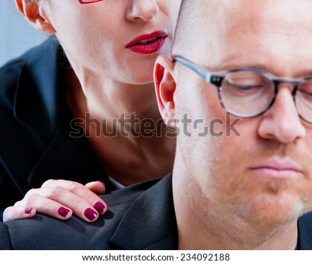 mobbing AKA woman tormenting a man on workplace - stock photo