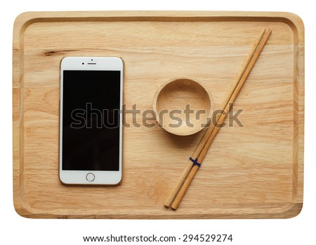 mobile and bowl chopstick made from wood on wood plate - stock photo