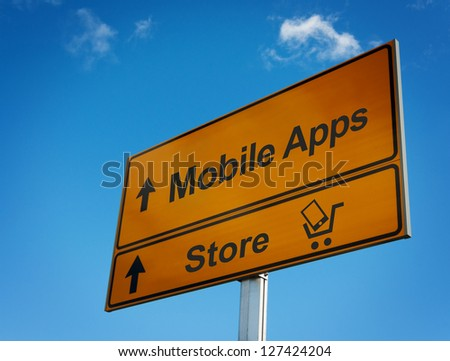 Mobile apps road sign with cart and smartphone. Concept development and marketing of mobile applications.