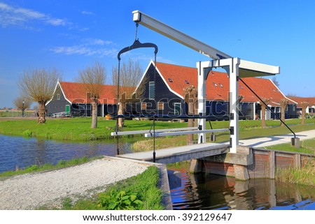 Mobile bridge and small canal in traditional village of Zaanse Schans, Holland