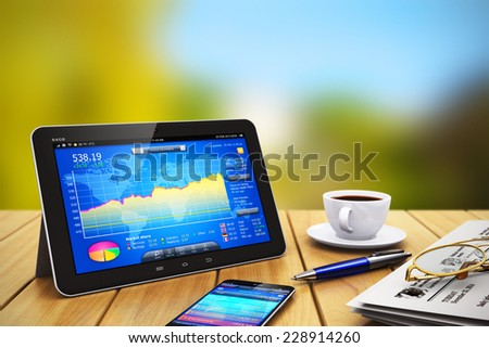Mobile business internet communication banking and wireless office web work and financial accounting success concept: tablet computer with stock exchange market application on wooden table outdoors - stock photo