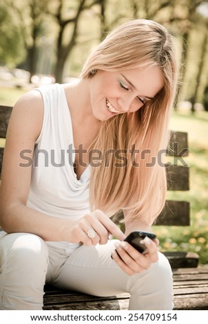 Mobile communication - smiling teenager - stock photo