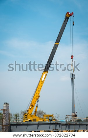 Mobile crane  lifting structural steel