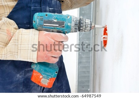 mobile drill in worker's hand