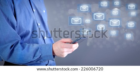 Mobile email in hand of businessman  - stock photo