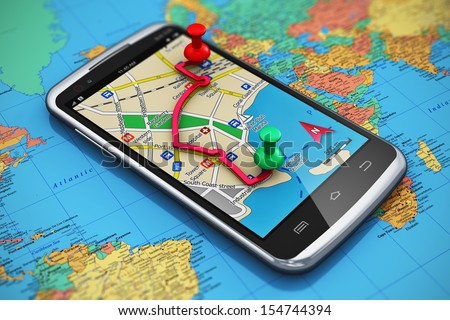 Mobile GPS navigation, travel and tourism concept: macro view of modern black glossy touchscreen smartphone with GPS navigation application, magnetic compass, pen and group of pushpins on world map - stock photo
