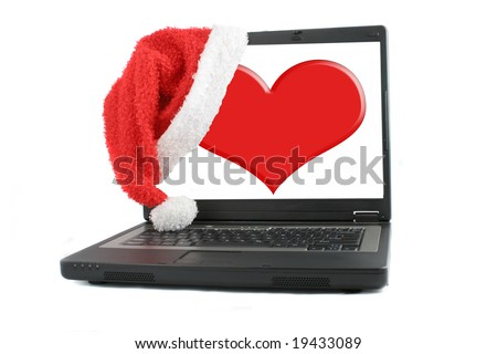 mobile laptop computer with santa christmas hat hanging off a heart  screen, online dating