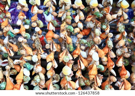 Mobile made from variety shells. - stock photo
