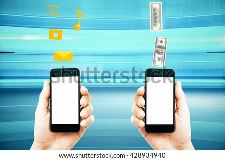 Mobile marketing and money transfer with male hands holding smart phones with blank white screens on abstract blue background. Mock up, 3D Rendering - stock photo
