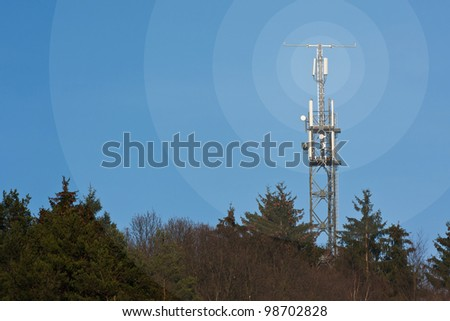 Mobile network radio mast in front of blue sky - stock photo