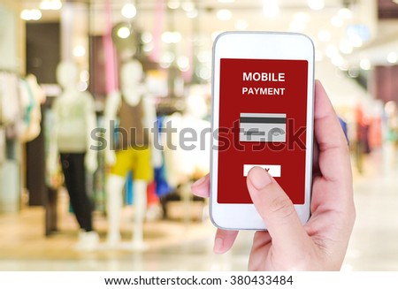 Mobile payment concept on smart phone screen over blur store background, e-commerce, smart pay, business and technology concept - stock photo