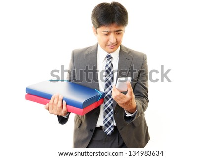 Mobile phone and business man - stock photo
