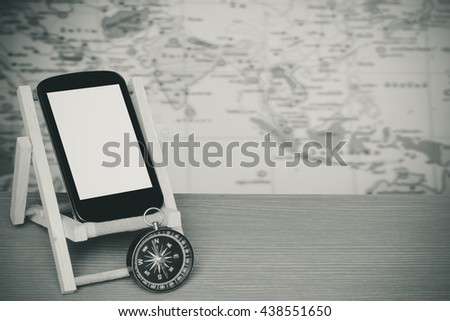 mobile phone and compass with blur part of world map,color filter tone background