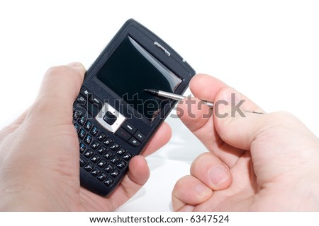 Mobile phone and handheld personal computer in hand