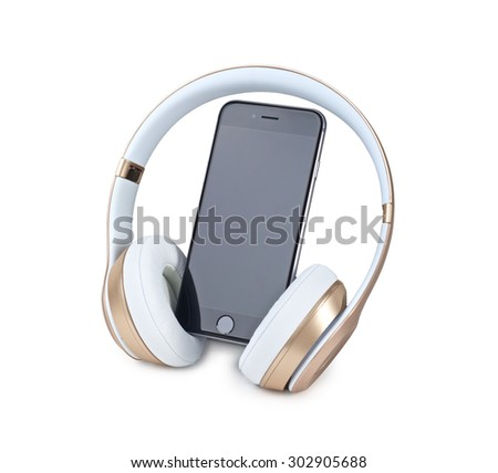 Mobile phone and headphone on white background