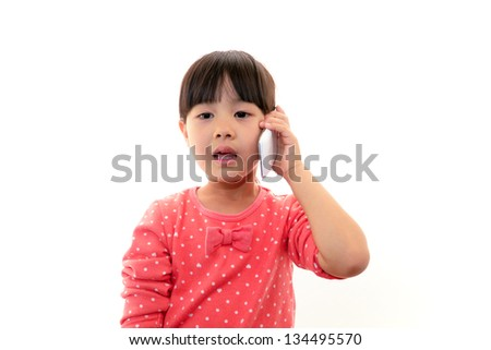 Mobile phone and little Asian girl
