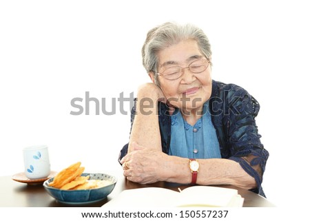Mobile phone and old woman