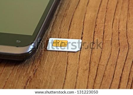 Mobile phone and sim - stock photo