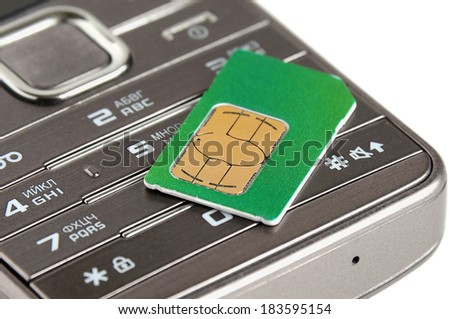 Mobile phone and sim card on a white background. Shallow depth of field - stock photo