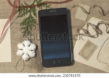 Mobile phone and the Christmas elements  in a vintage style - stock photo