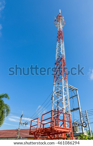 Mobile phone base station tower in blue sky.