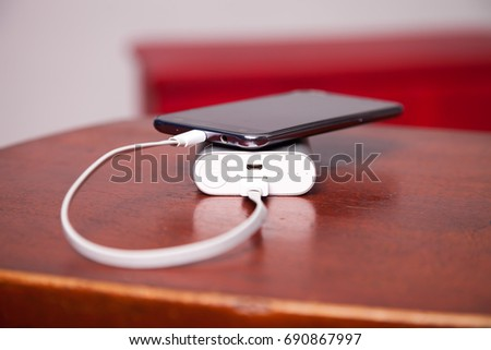 Mobile Phone Charging With Power Bank and usb cord on table