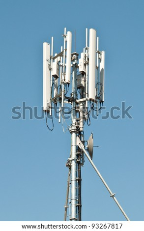 Mobile phone communication against blue sky