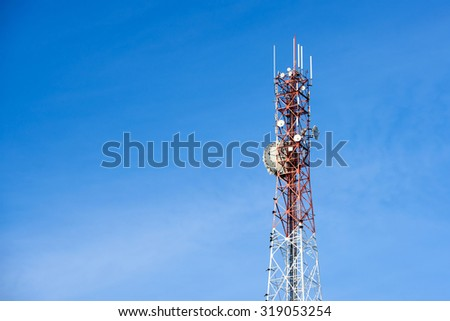 Mobile phone communication antenna tower with the blue sky - stock photo