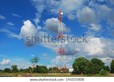 Mobile phone communication antenna tower with the blue sky and clouds - stock photo
