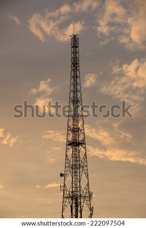 Mobile phone communication repeater antenna tower as Silhouette background