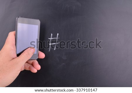 Mobile Phone Concept with blackboard and a hash mark handwritten