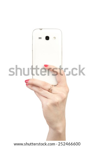 Mobile phone in hand girl turned the camera to the viewer.  - stock photo