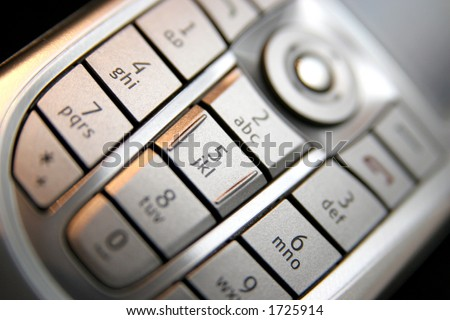 mobile phone keypad in closeup - stock photo