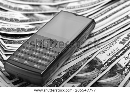 mobile phone on the money background